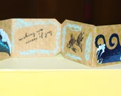 "Miniature Book Porthole Anchor Life Bouy Cancelled Conch Shell Stamp ""Wishing You Oceans of Joy"""