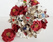 Alternative bouquet wedding flowers paper origami vintage rockabilly red gold sailor jerryanchor rose swallow tattoo theme bride dress sash