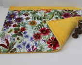 Yellow floral weighted lap blanket.