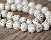 A strand of 11 simple carved stoneware beads, NATURAL, RUSTIC and EARTHY ceramic handmade jewelry component