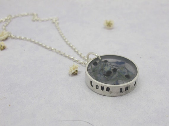 Resin and recycled silver long pendant with petals and seeds from Nigella plant, love in a mist