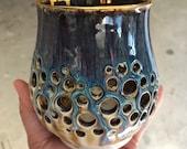 Wheel thrown hand carved porcelain candle holder
