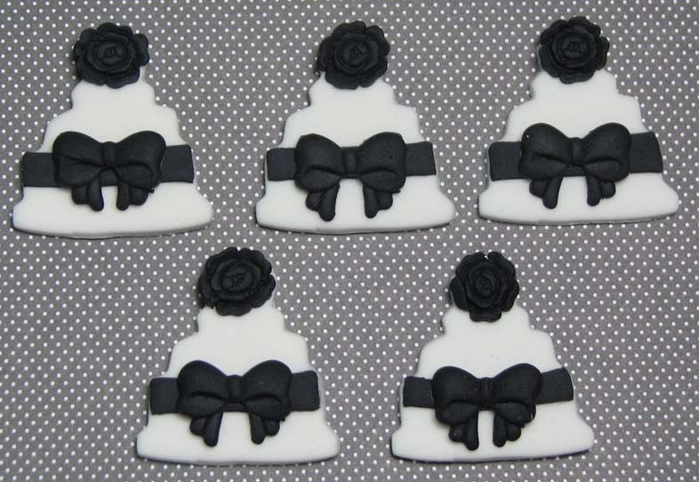This listing is for 12 Wedding cake black and white cupcake toppers made out