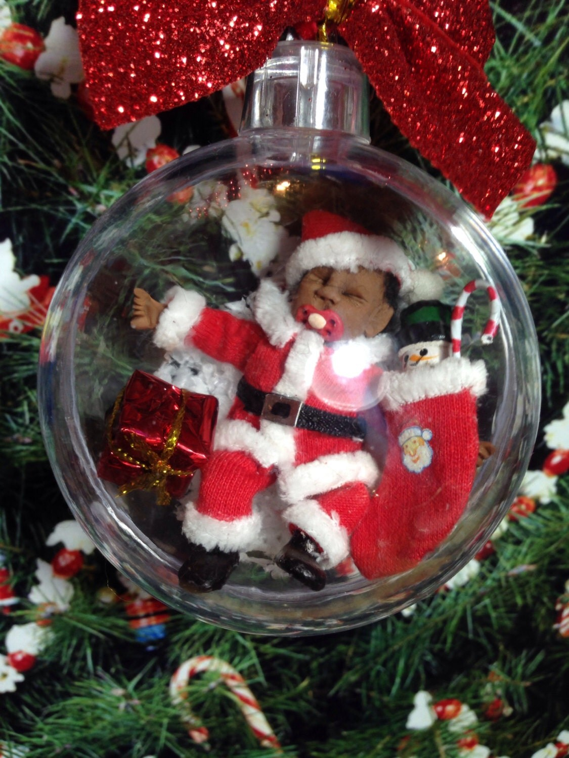 Now reduced to clear dolls house ooak ethnic baby santa in christmas bauble with handmade stocking and present 112 scale