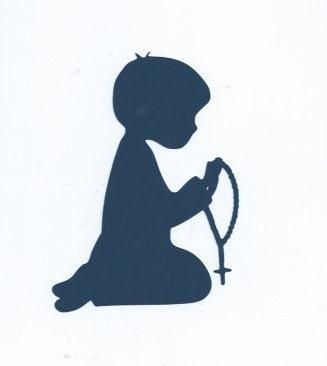 Boy praying Rosary silhouette