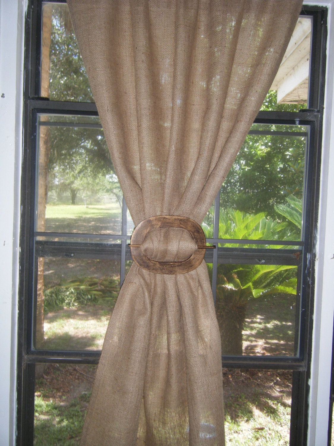 Curtain holdback placement