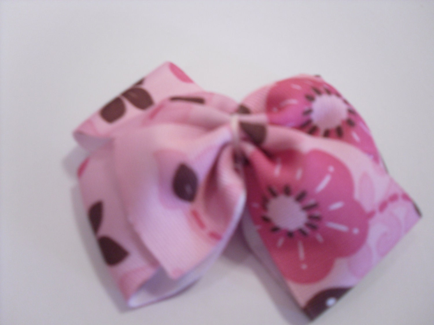 Pink bow with dark pink and brown flowers