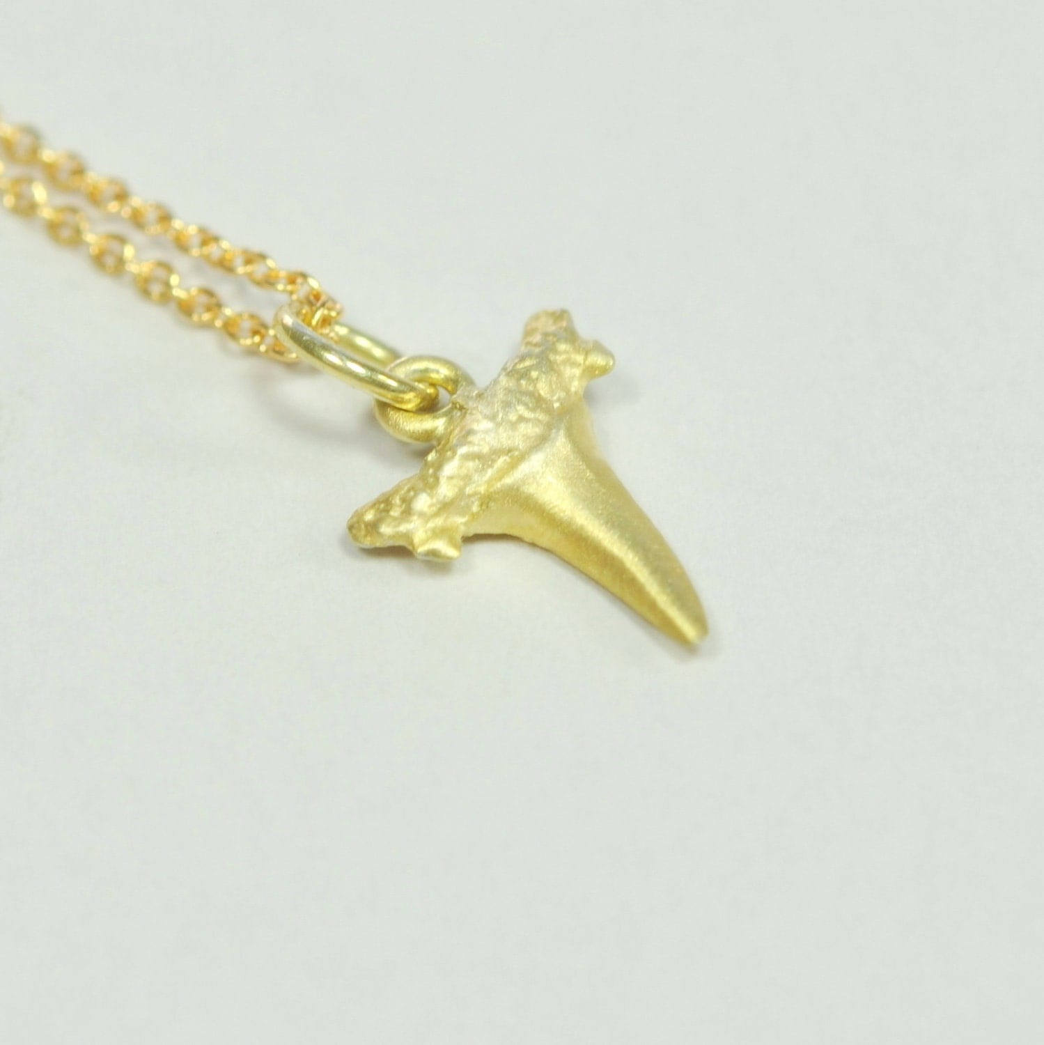 solid 14k gold shark tooth pendant by shopeliandleah on etsy