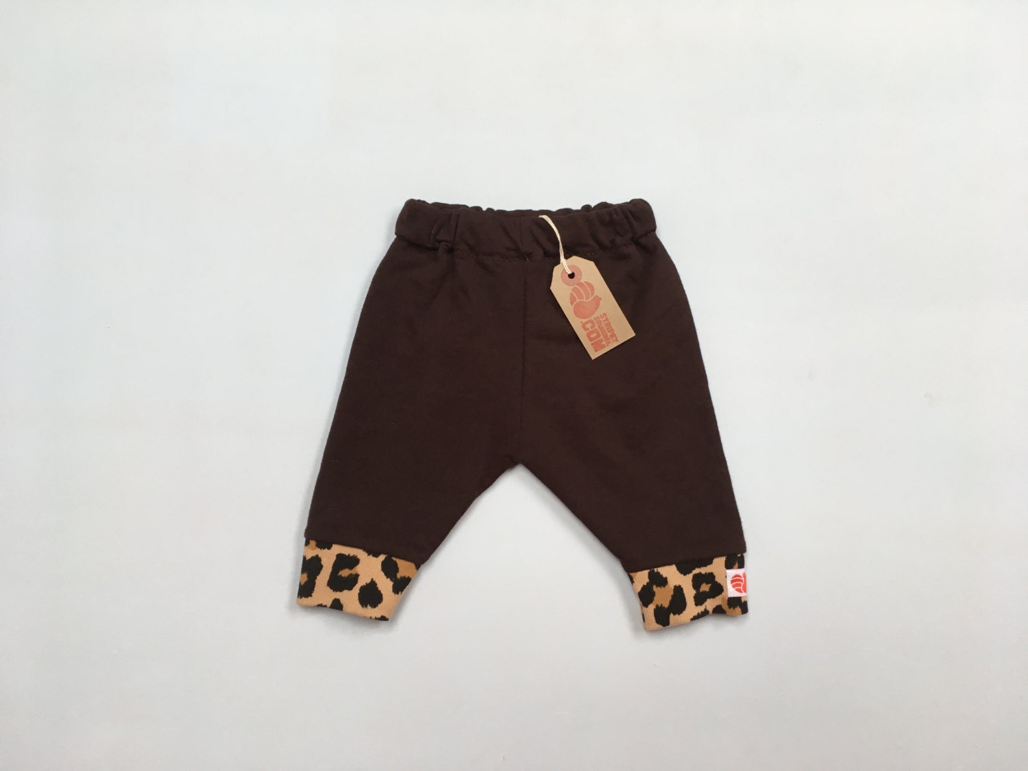 Soft brown trousers with animal print cuff. 36 months. Unisex.