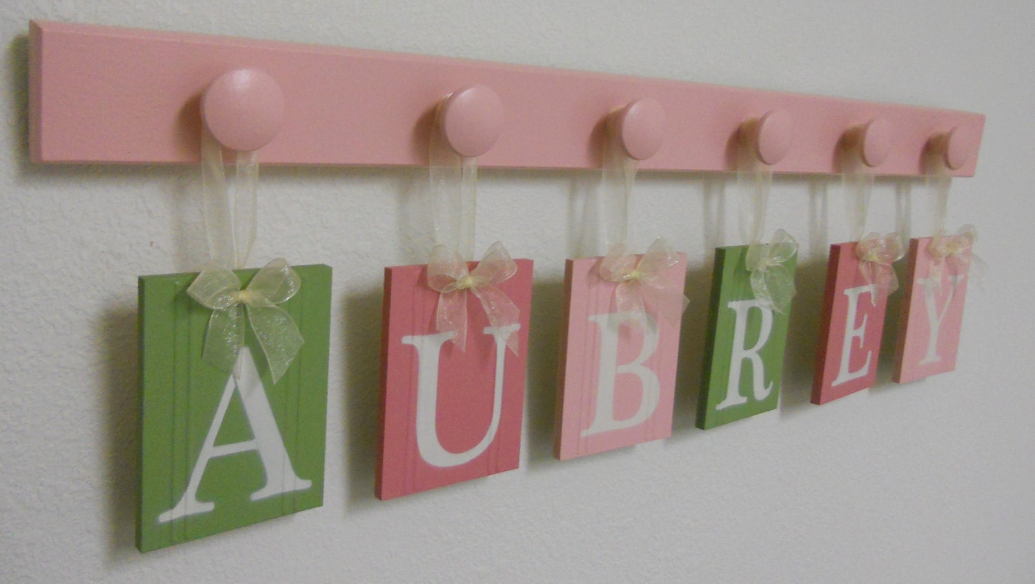 Baby Girl Wooden Letters Sign Includes Personalized Alphabet Wall letters and 6 Pegs- Light Green, Pinks. Custom Order for AUBREY