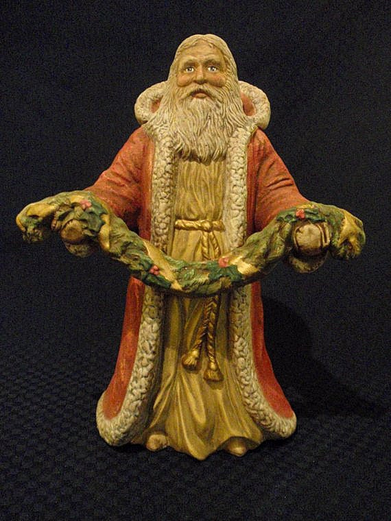 Santa claus ceramic figurine with garland by gone pieces