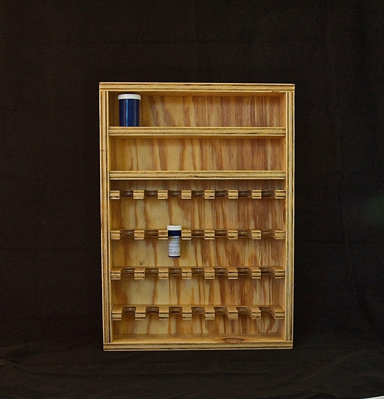 Items similar to contemporary poppy flower scissor rack for Pill bottle storage rack