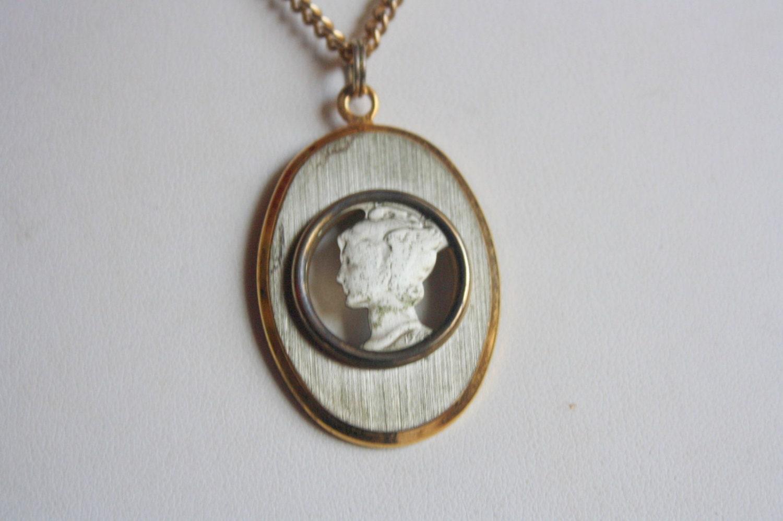 beautiful vintage cutout 1940s mercury dime pendant by