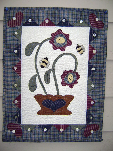 flower basket with bees folk art quilt wallhanging  this quilt measures 18