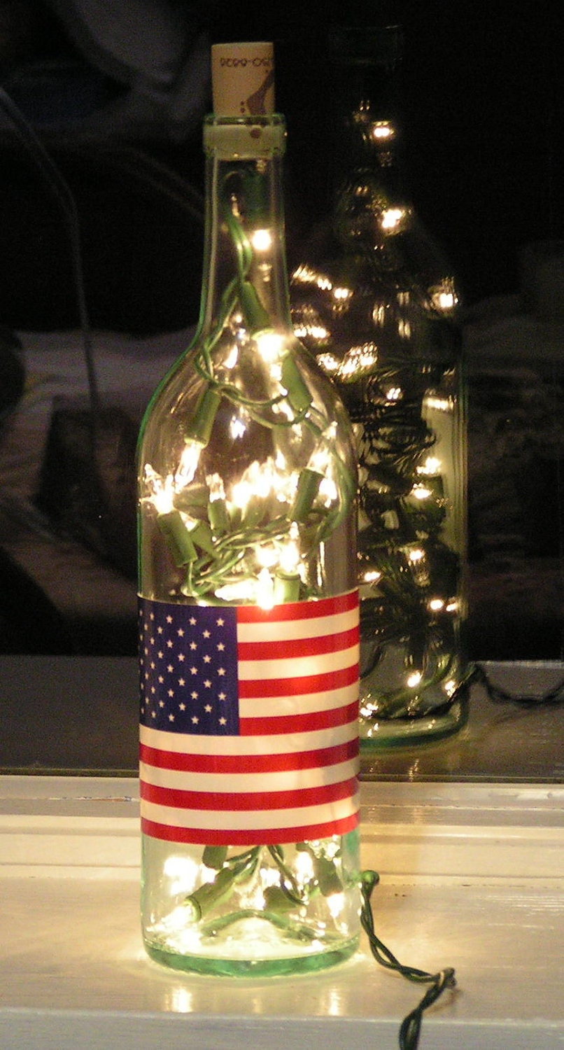 clear wine bottle light with white lights inside and by