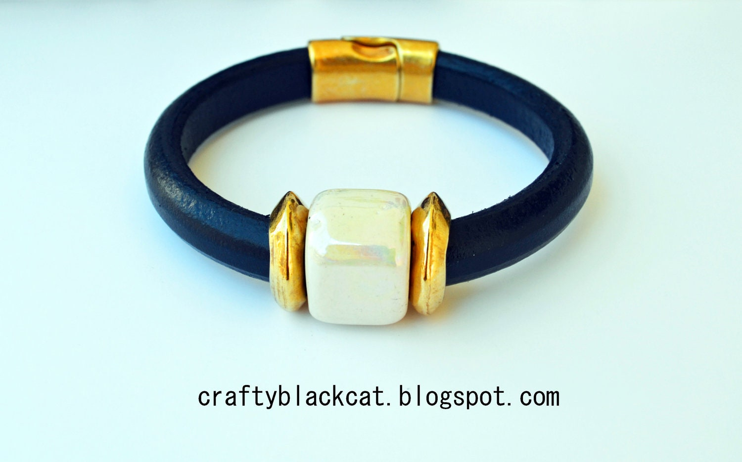 Regaliz leather bracelet in navy blue colour with white ceramic bead, metallic parts and magnetic clasp. - TheCraftyblackcat