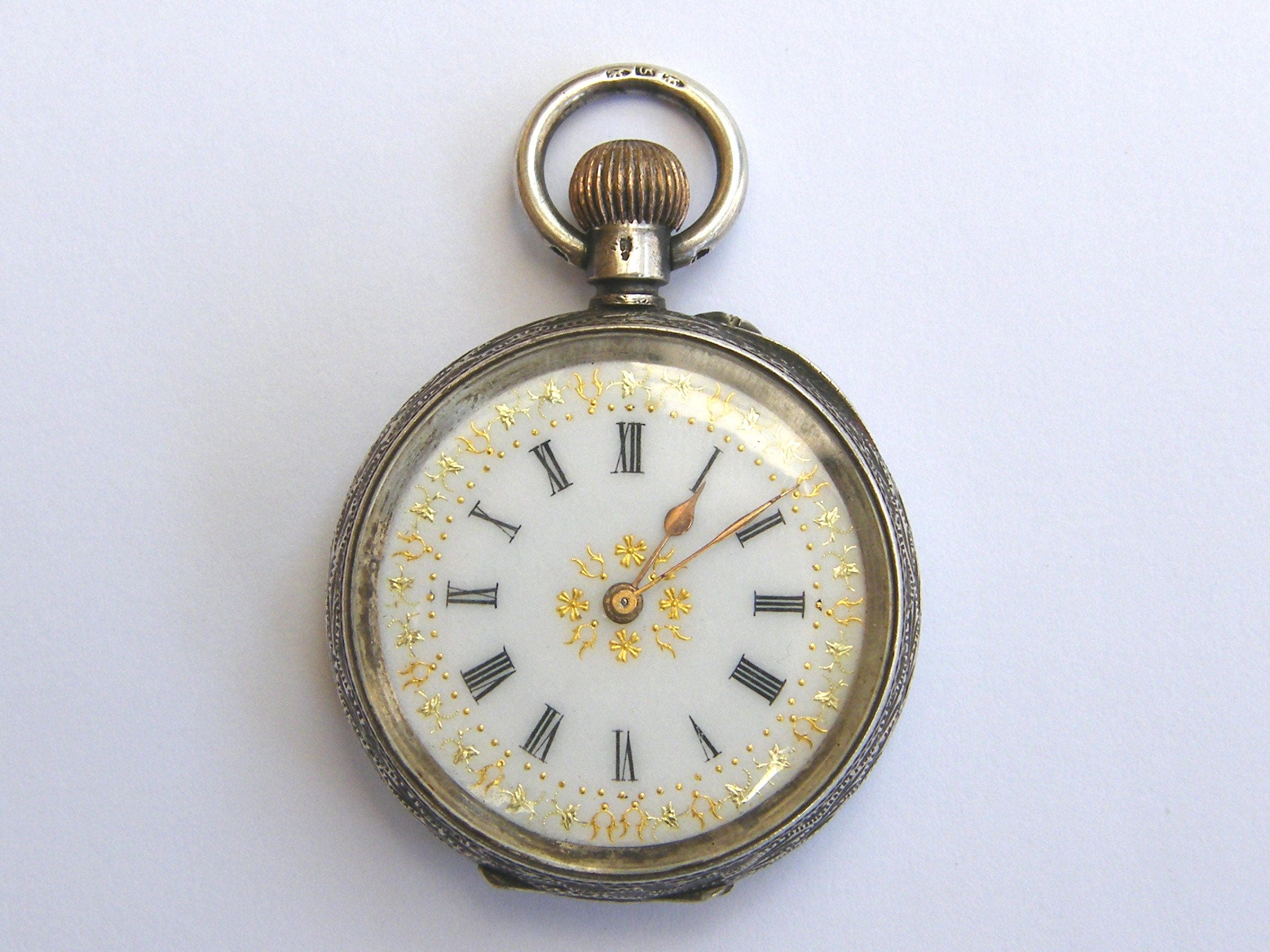 AntiqueSwiss Solid Silver Ladies Pocket Watch With GoldEnamel FaceGWOcirca 1900