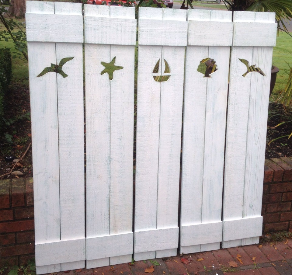 Unavailable listing on etsy for Beachy exterior shutters