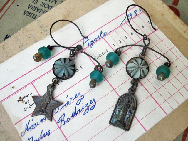 Masks of Divinity. Teal Lampwork and Antique Religious Medal Dangles.