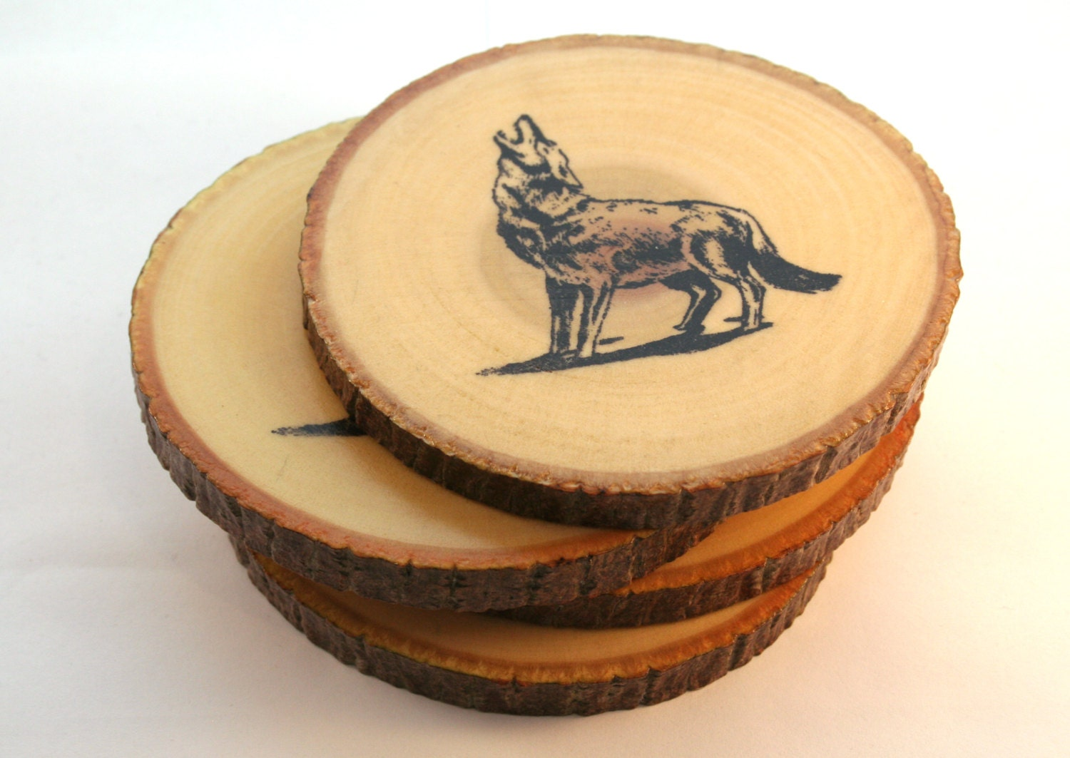 Handmade wooden howling wolf coasters hand stamped by for Handmade drink coasters