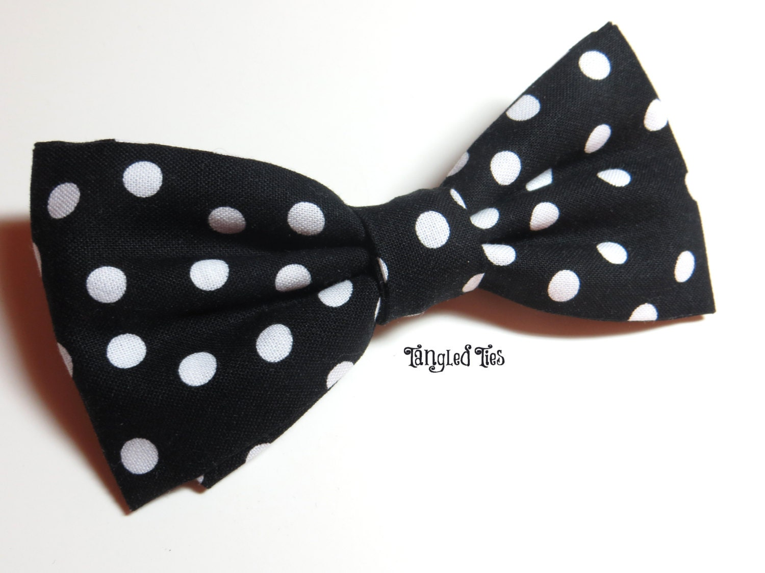 scattered black and white polka dot bow tie by