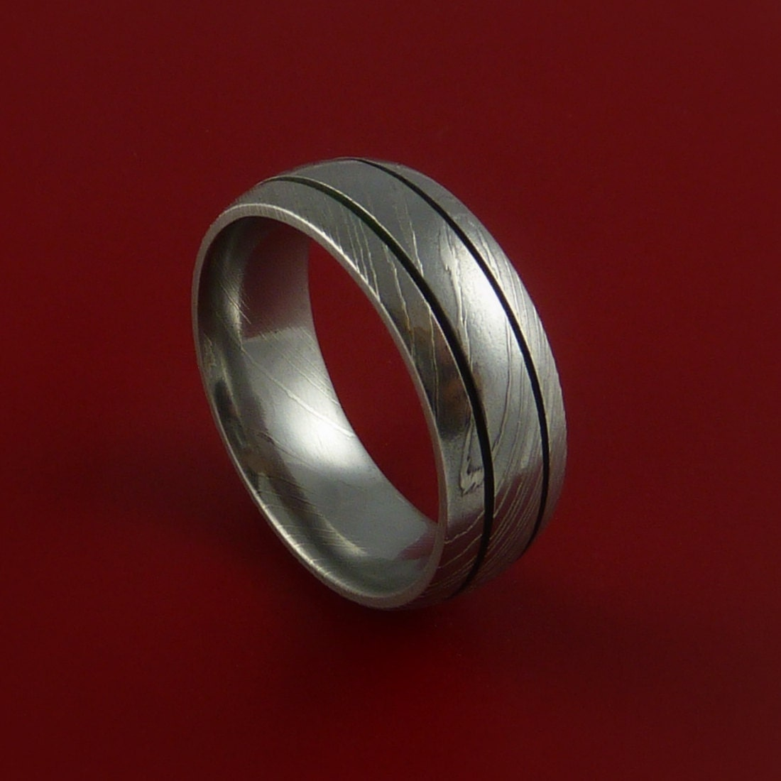 awesome photograph of damascus steel wedding band