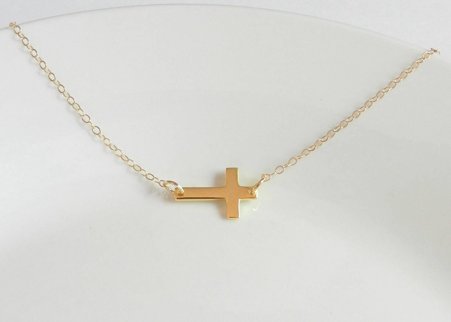 Gold sideways cross 14k gold