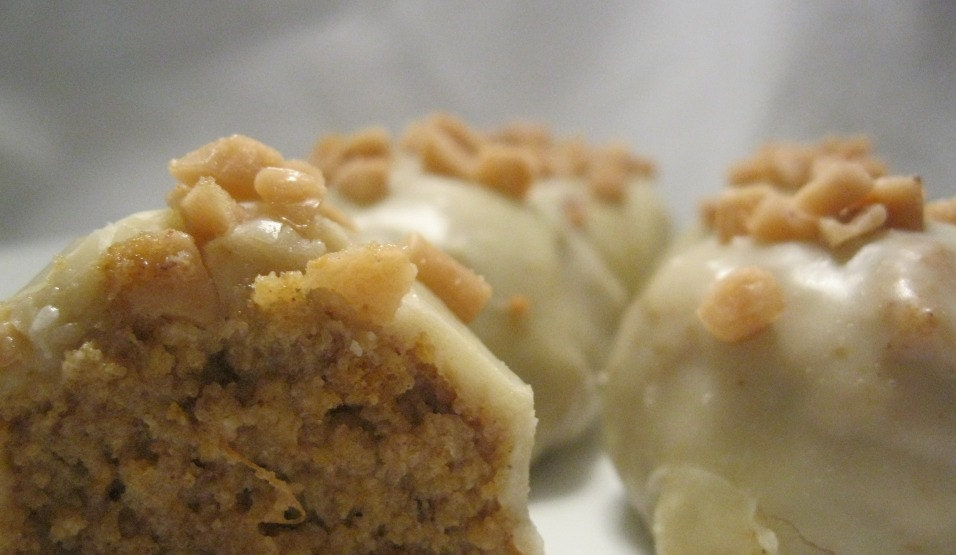 Pumpkin Spice & Toffee Chip Cake Truffles with White Chocolate Glaze