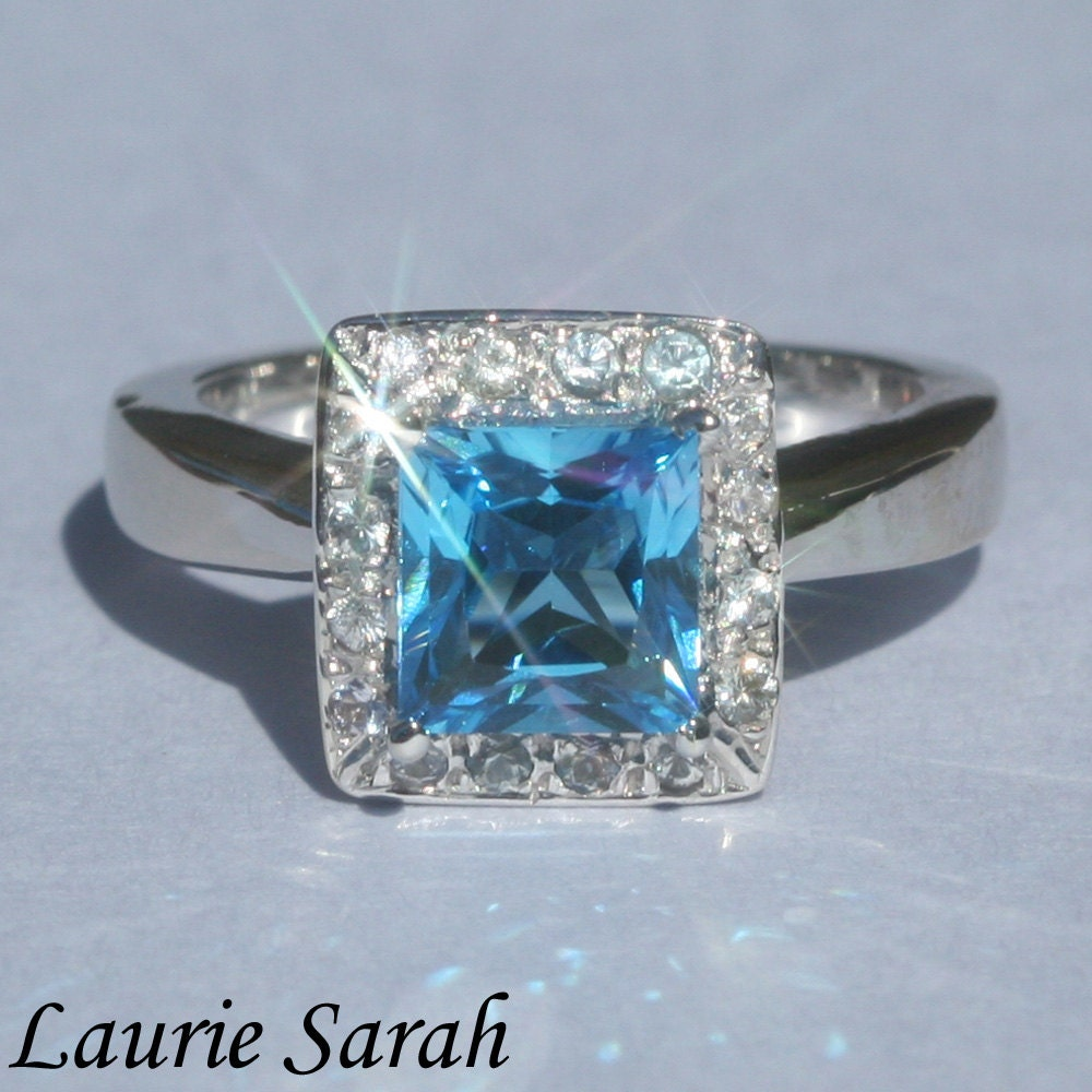 princess cut blue topaz ring with by