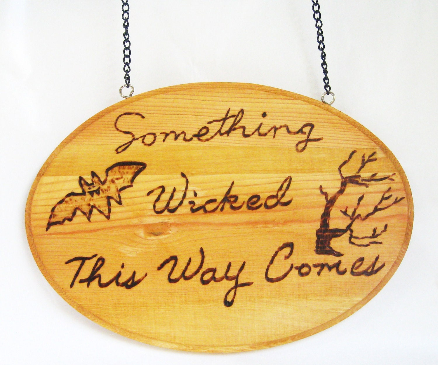 Rustic wood burned Halloween decoration.Something Wicked this way comes