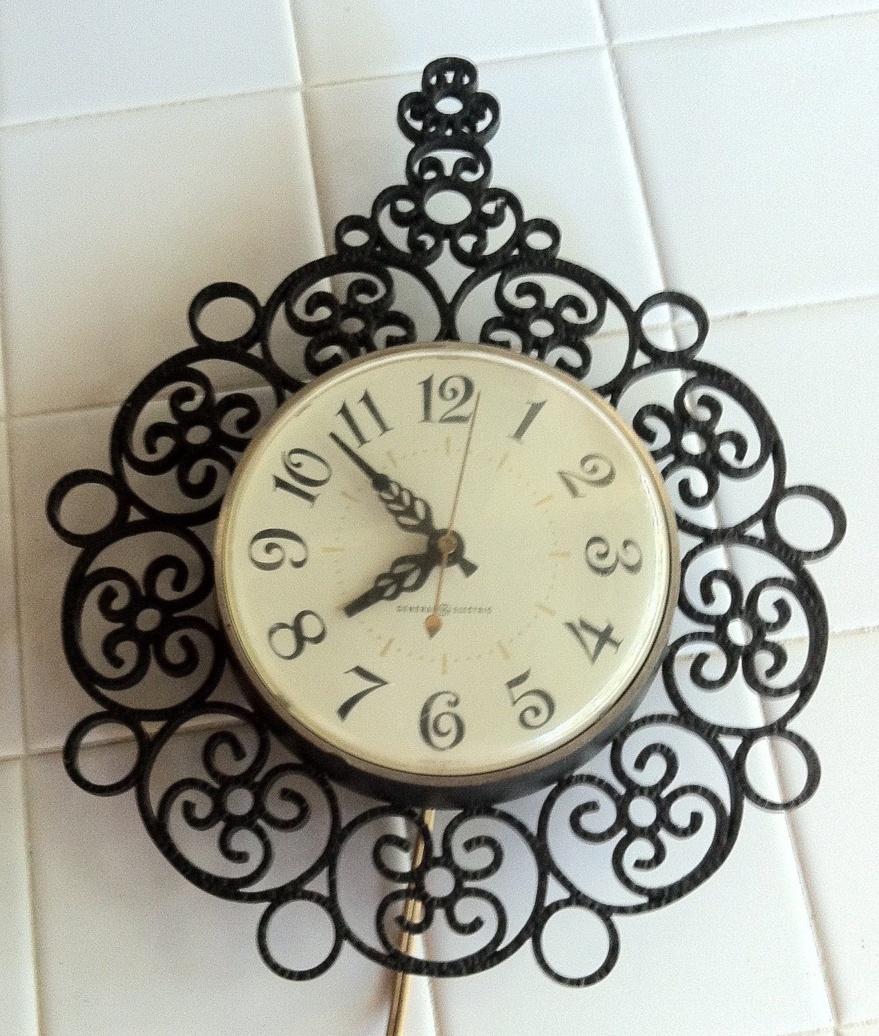 ge wall clock black wrought iron look lattice by