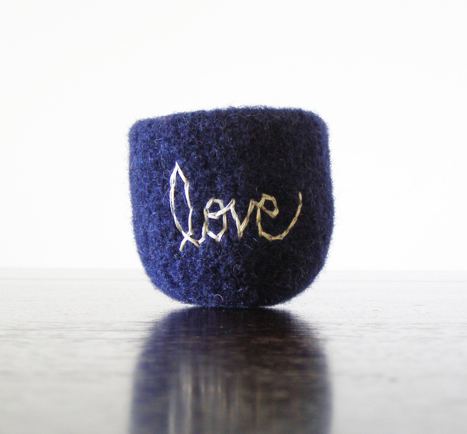 "navy blue felted wool bowl with white word ""love"" embroidered with cotton embroidery floss - ring bowl, jewelry organizer, anniversary gift - theFelterie"