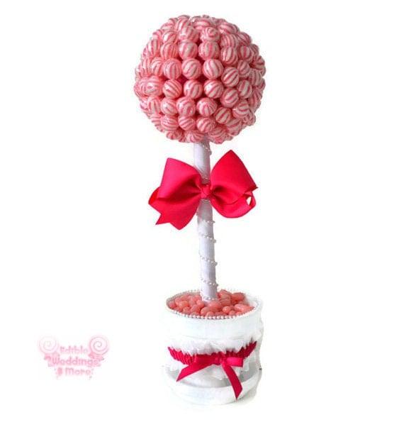 Pink lollipop bride topiary candy by edibleweddings