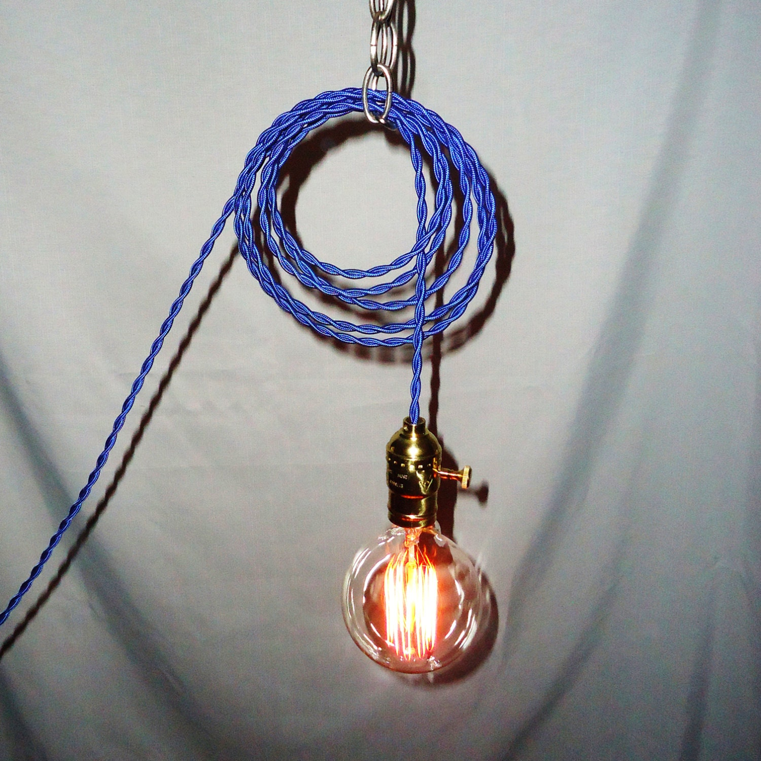 hanging lamp twisted blue cord exposed edison bulb. Black Bedroom Furniture Sets. Home Design Ideas