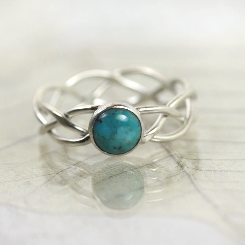 braided silver ring set with turquoise by