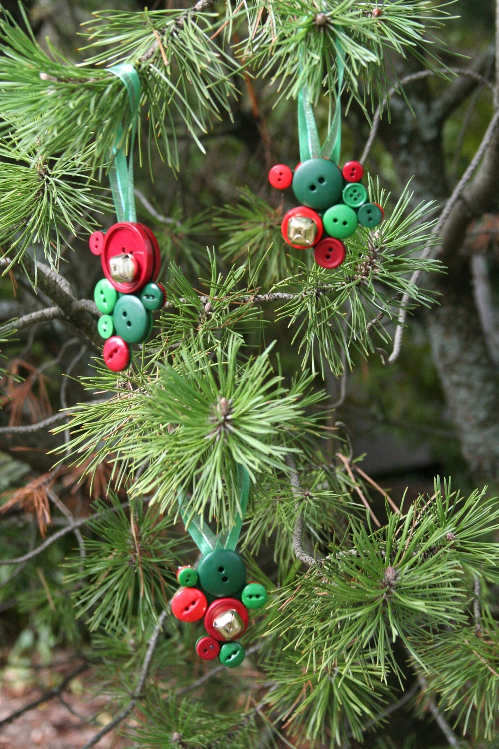 Christmas ornaments made with jingle bells and button by