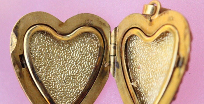 antique ornate solid 10k gold heart locket pendent  this is hallmarked on