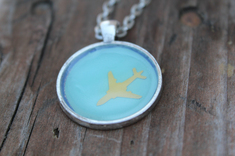Getaway airplane pendant