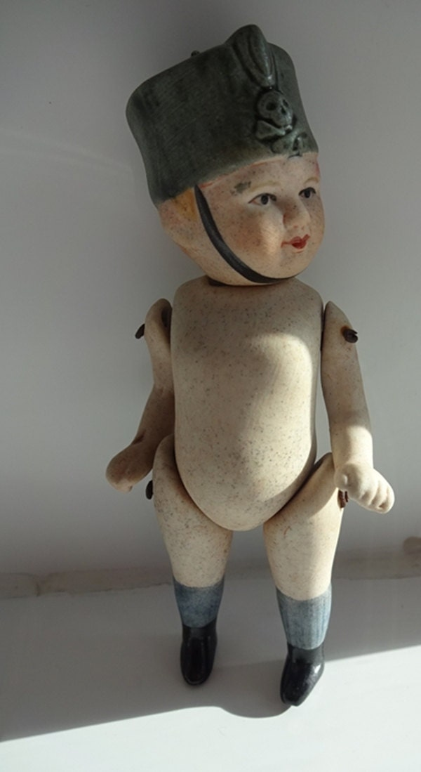 Bisque Boy Doll Miniature Porcelain Doll Reproduced  In The Style Of A1920s jointed Bisque mignonette Boy Soldier Imperial Guard