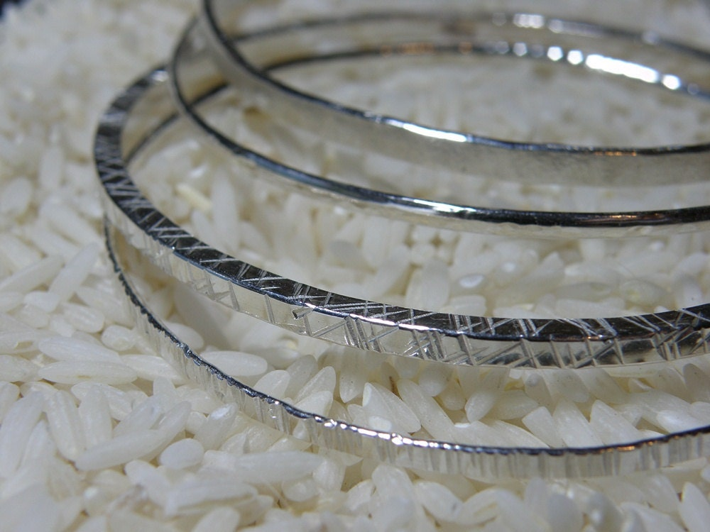 Four Silver Bangles