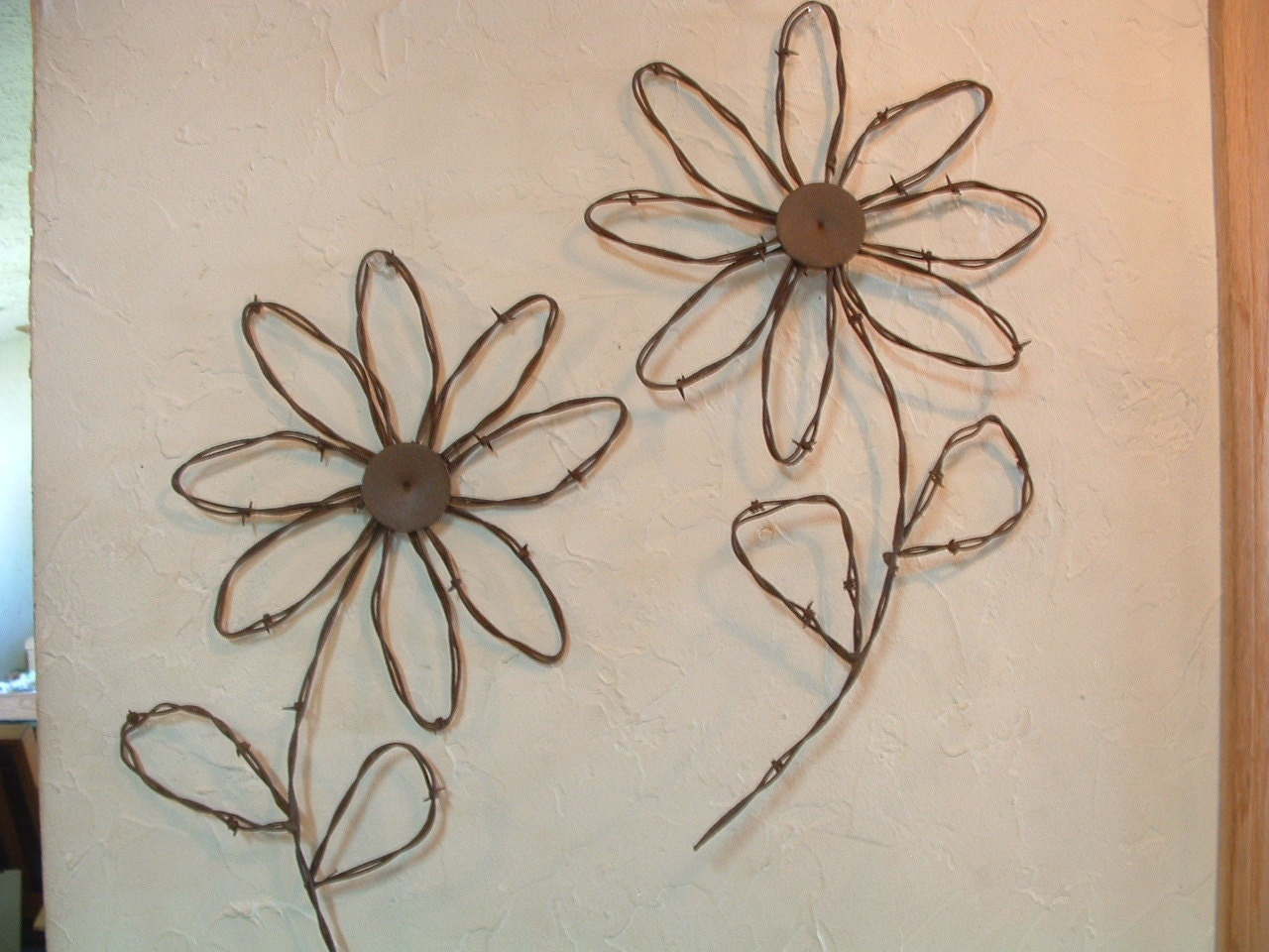 Rustic western rusty barbed wire sunflower wall by