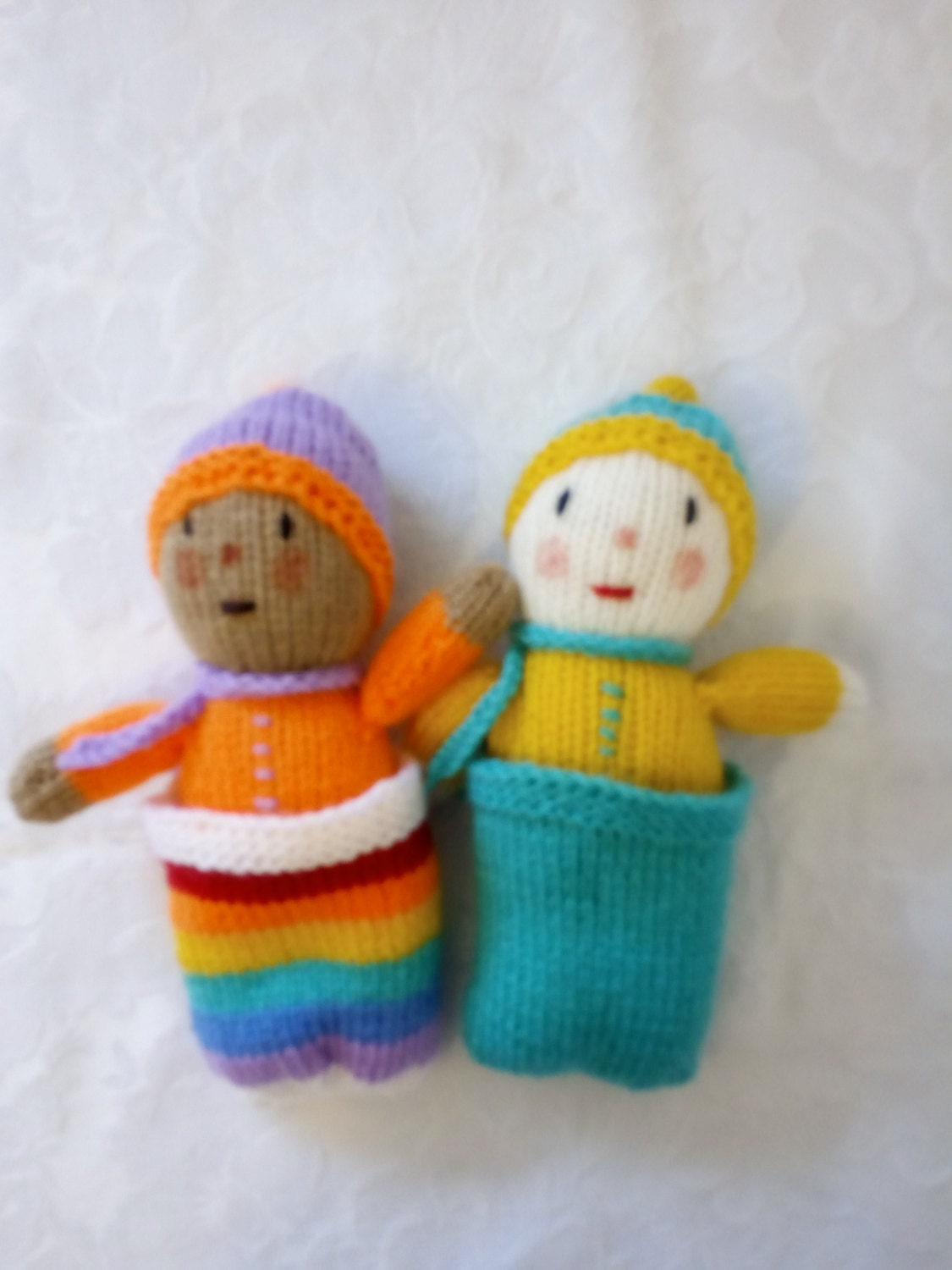 Adorable hand knitted babies in sleeping sacks and caps designed by Jean Greenhowe knitted by Liz