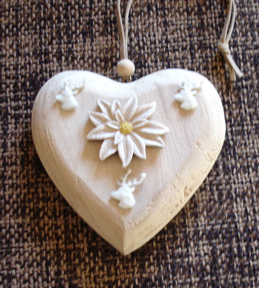 Items similar to edelweiss and stag wooden heart ornament
