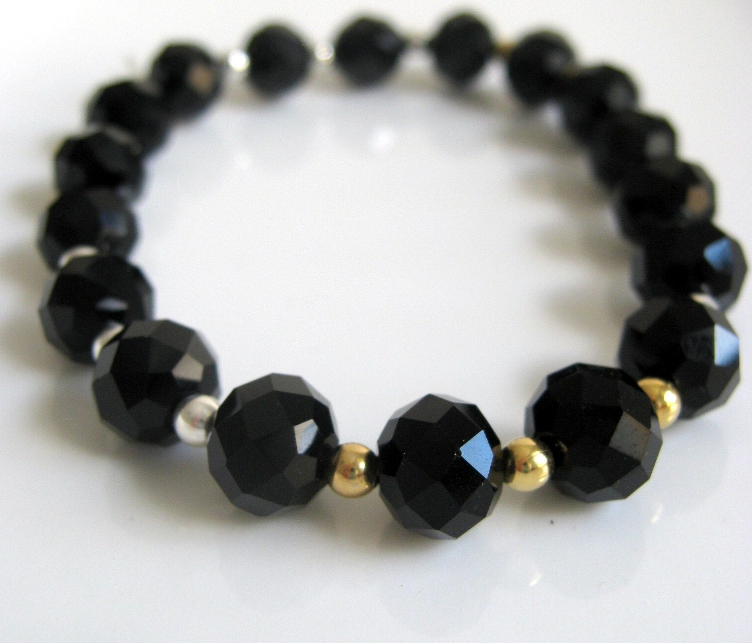 black crystal stretch bracelet with gold and silver accents