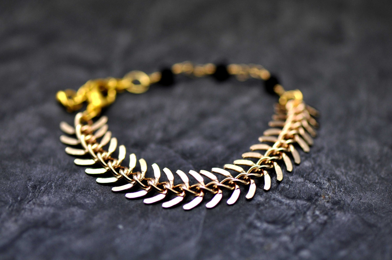 Fishbone bracelet, made with gold plated fishbone chain and a beautiful chain maid with black crystals - BBTAR
