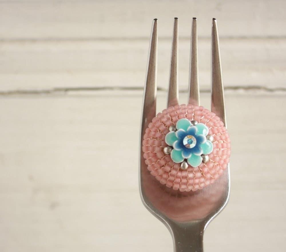 Ring, beadwoven, matte peach with turquoise blue enamel flower centre - afrikitten