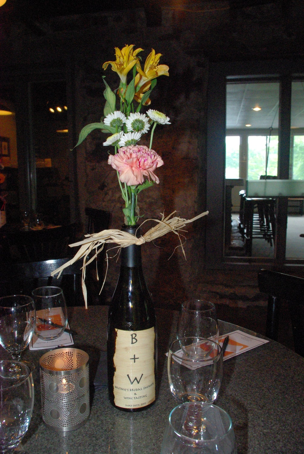 Rustic wine bottle centerpiece by homebakedpapergoods on etsy Wine bottle wedding centerpieces