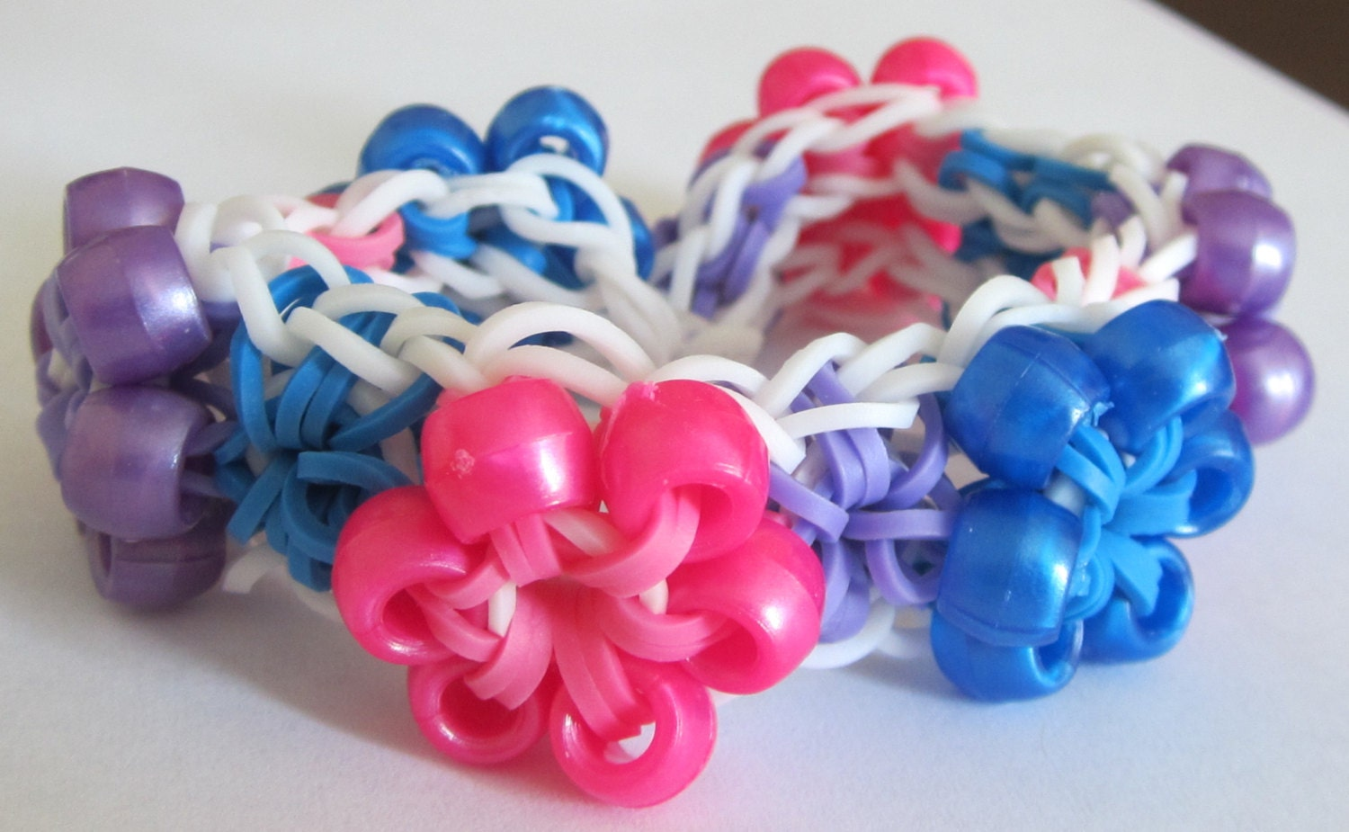 items similar to starburst with rubber band bracelet