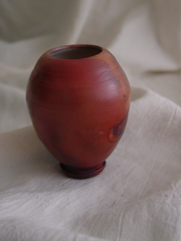 tiny terra cotta colored vase