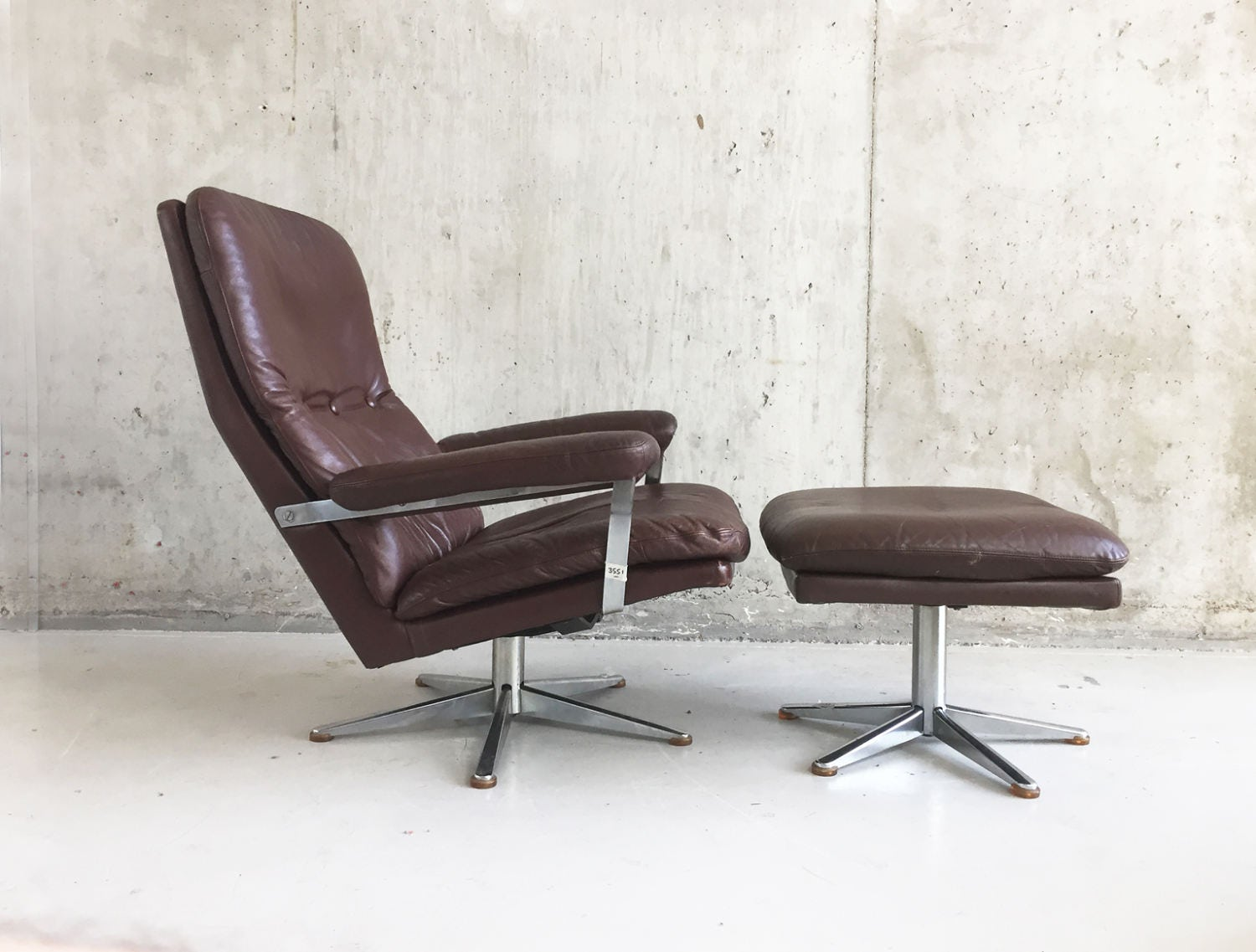 1970s Danish Mid century chestnut brown leather swivel armchair with matching footstool